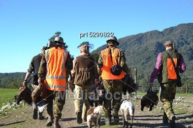 Group Of Friends Return From Their Pheasant Hunt With Plenty Of Game On The West Coast Of New Zealand Stock Photo