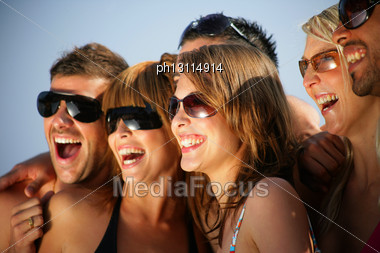 Group Of Happy Young People On Holiday Stock Photo