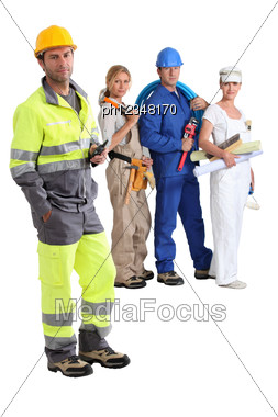 Group Of Manual Workers Stock Photo