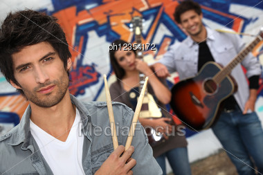 Group Of Musicians Busking On The Streets Stock Photo