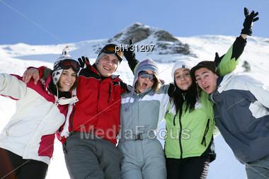 Group Of Teenage Skiers Having Fun Stock Photo