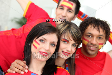 Group Of Young Spanish Football Supporters Stock Photo