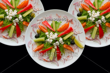 Group Of Plates With Salad On Black Background Stock Photo