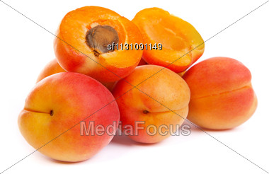 Group Of Ripe Apricots With A Half Isolated On A White Background Stock Photo