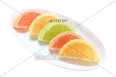 Group Of Sweets As Citrus Fruits On White Plate Close-up Studio Photography Stock Photo