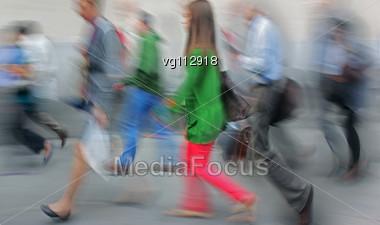 Group Of A Tourists Walking On A Sidewalk, Intentional In Camera Motion Blur Stock Photo