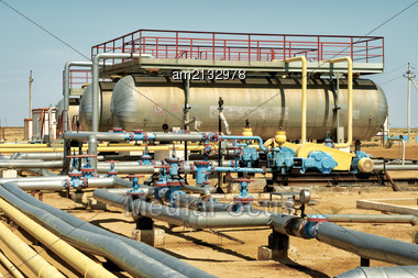 Group Unit Pumping Oil Pumps In The Foreground Stock Photo