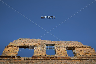 Grunge Bricks Wall With Empty Window On The Blue Sky Background Stock Photo