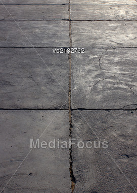 Grunge Concrete Cement Way With Cracks At Sun Light Stock Photo