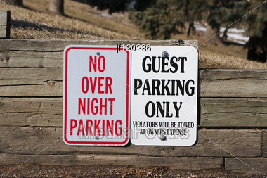 Guest Parking Only And No Overnight Parking Sign. Stock Photo
