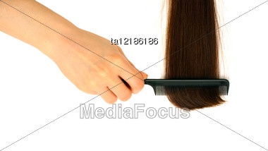 Hairbrush And Lock Of Hair Stock Photo