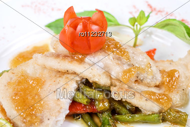 Halibut Filet Roast At Lime Juice With Vegetables Stock Photo