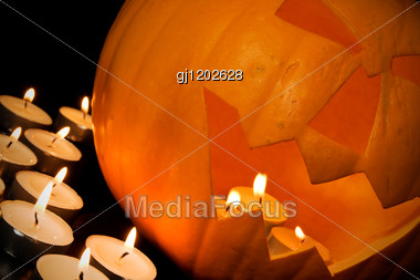 Halloween Pumpkin And Candles In A Darkness Stock Photo