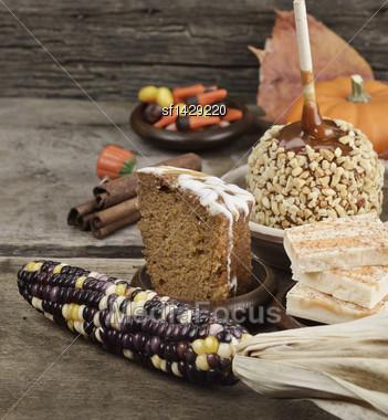 Halloween Treats - Caramel Apple ,Pumpkin,Cake And Candies Stock Photo