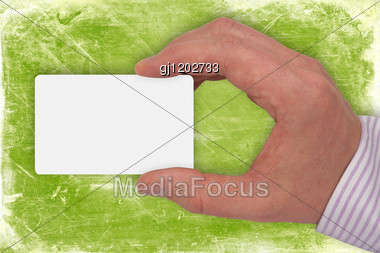 Hand With Blank Card On Green Background Stock Photo