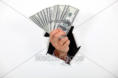 Hand Fanning Dollars Stock Photo
