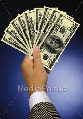 Hand Holding Bills Stock Photo