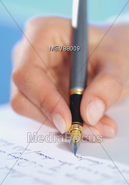 Hand Holding Fountain Pen Writing Stock Photo