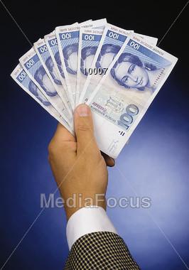 Hand Holding German Bills Stock Photo