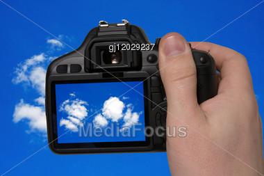 Hand Holding Photo Camera And Taking Sky Photography Stock Photo