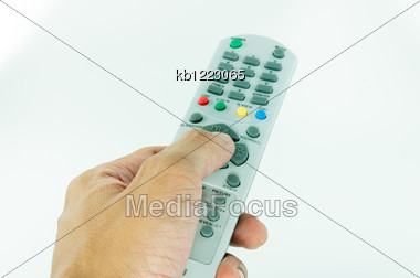 Hand Holding Remote Control Stock Photo