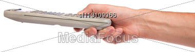 Hand Holding A Remote Control Isolated Over A White Background Stock Photo