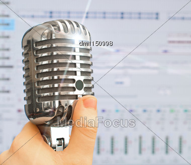 Hand Holding Retro Microphone Over Recording Software Background Stock Photo