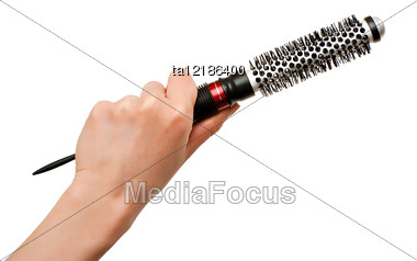 Hand Holding Thermal Round Hairbrush Stock Photo