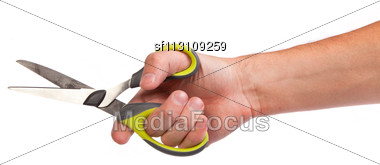 Hand Is Holding Scissors Isolated On A White Background Stock Photo