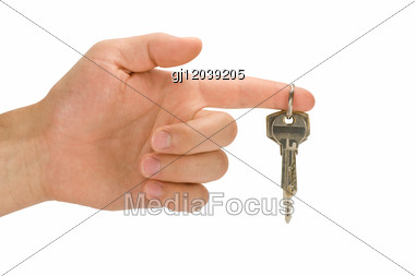 Hand With Keys On Forefinger Stock Photo