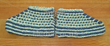 Hand Knitted Baby Booties Stock Photo