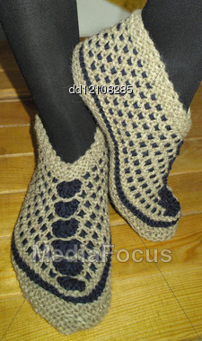 Hand Knitted Female Slippers Stock Photo