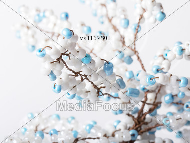 Hand Made Tree Branch Decorated With Beads Isolated. Close Up Stock Photo