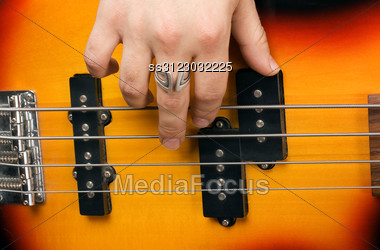 Hand Of The Artist On Guitar Strings Stock Photo
