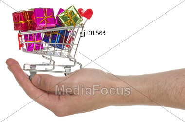 Hand With Shopping Cart Full Of Gifts. Isolated On White Background Stock Photo