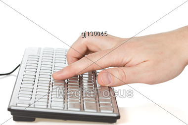 Hand Typing On Computer Keyboard Stock Photo