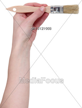 Hand With A Painting Brush Stock Photo