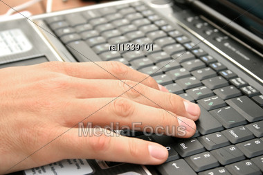 Hand Working On Laptop. Stock Photo