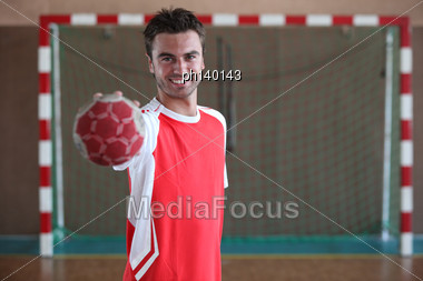 Handball Player In Front Of Goal Stock Photo
