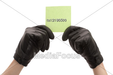 Hands In Black Gloves Holding A Sheet Of Blank Paper Stock Photo