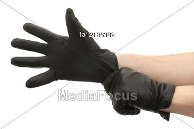 Hands In Black Gloves Stock Photo