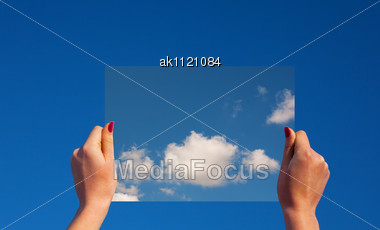 Hands Holding A Frame With Clouds Against Clear Blue Sky Stock Photo