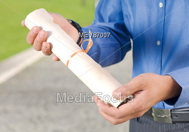 Hands Holding Graduation Diploma Stock Photo