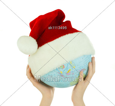Hands Holds Globe With Santa's Hat Stock Photo