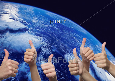 Hands Inch Raised On A Planet Ground Stock Photo
