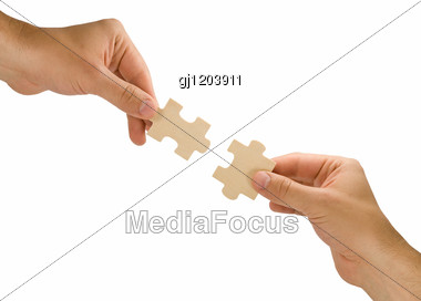 Hands With Pieces Of Puzzle Stock Photo