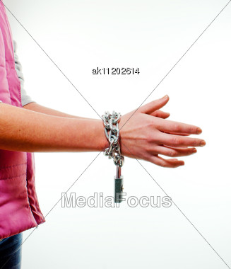 Hands Tied Up With Chains Against Light Background Stock Photo