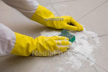 Hands In Yellow Gloves With Sponge, Washing Floor Stock Photo