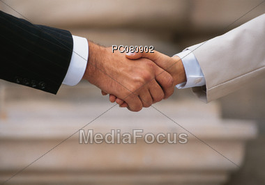 Handshake between Business Woman and Man Stock Photo