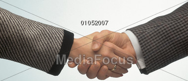 Handshake Between Woman and Man Stock Photo